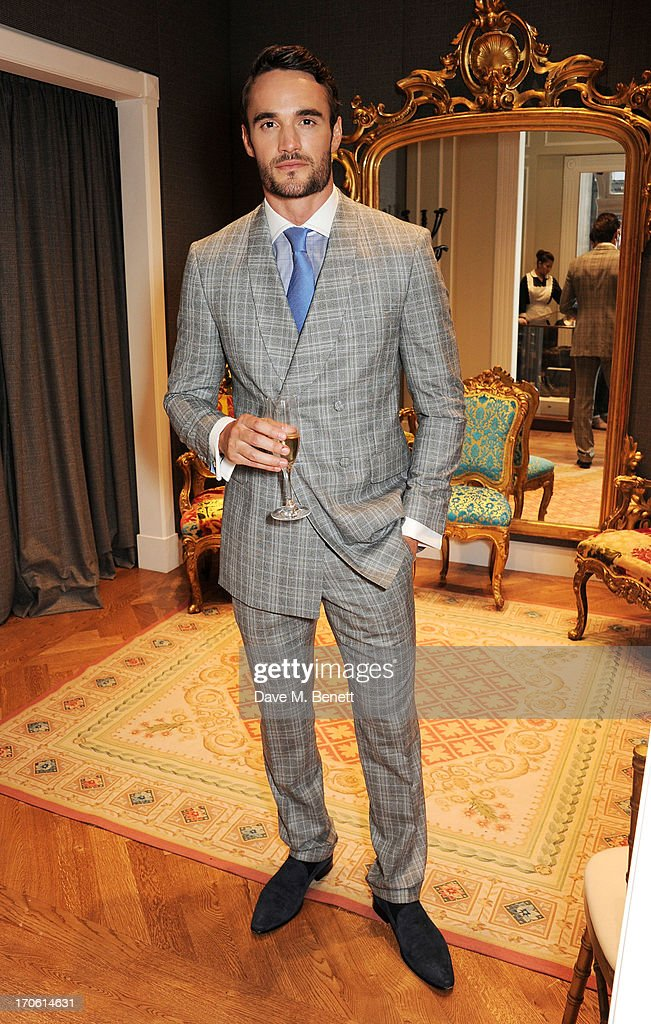 <a gi-track='captionPersonalityLinkClicked' href=/galleries/search?phrase=Thom+Evans&family=editorial&specificpeople=825883 ng-click='$event.stopPropagation()'>Thom Evans</a> attends the opening of the new Dolce & Gabbana men's store with a preview of the Summer 2014 Tailoring Collection at Dolce & Gabbana on June 15, 2013 in London, England.