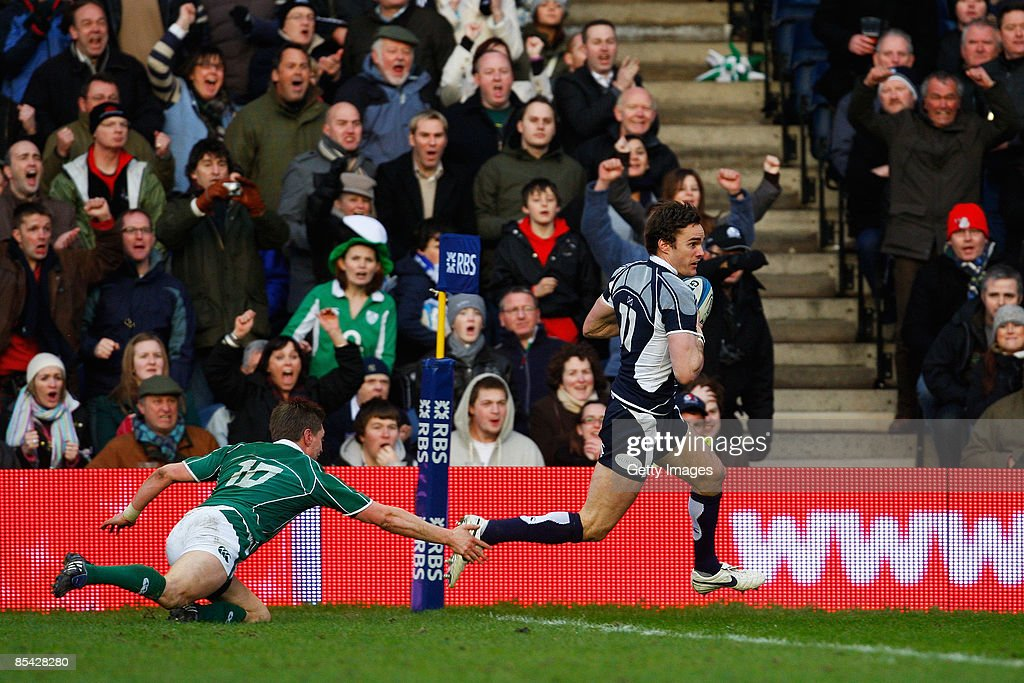 Thom Evans of Scotland gets past Ronan O'Gara of Ireland to score a try during the RBS Six Nations Championship match between Scotland and Ireland at Murrayfield Stadium on March 14, 2009 in Edinburgh, Scotland.