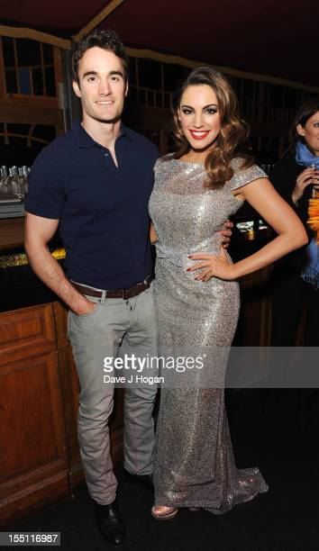 Thom Evans poses with Kelly Brook at a curtain call after her first performance of a run of shows with Forever Crazy at The Forever Crazy Spiegel...