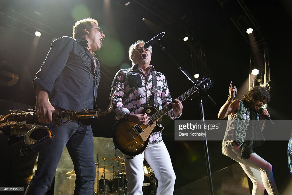 <a gi-track='captionPersonalityLinkClicked' href=/galleries/search?phrase=Thom+Gimbel&family=editorial&specificpeople=5088915 ng-click='$event.stopPropagation()'>Thom Gimbel</a> of the group Foreigner and <a gi-track='captionPersonalityLinkClicked' href=/galleries/search?phrase=Mick+Jones+-+Musician+-+Foreigner&family=editorial&specificpeople=11267705 ng-click='$event.stopPropagation()'>Mick Jones</a> of the group Foreigner performs at Prudential Center on June 26, 2014 in Newark, New Jersey.