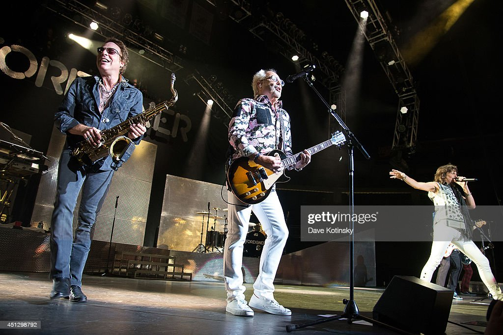 Thom Gimbel of the group Foreigner and Mick Jones of the group Foreigner performs at Prudential Center on June 26, 2014 in Newark, New Jersey.