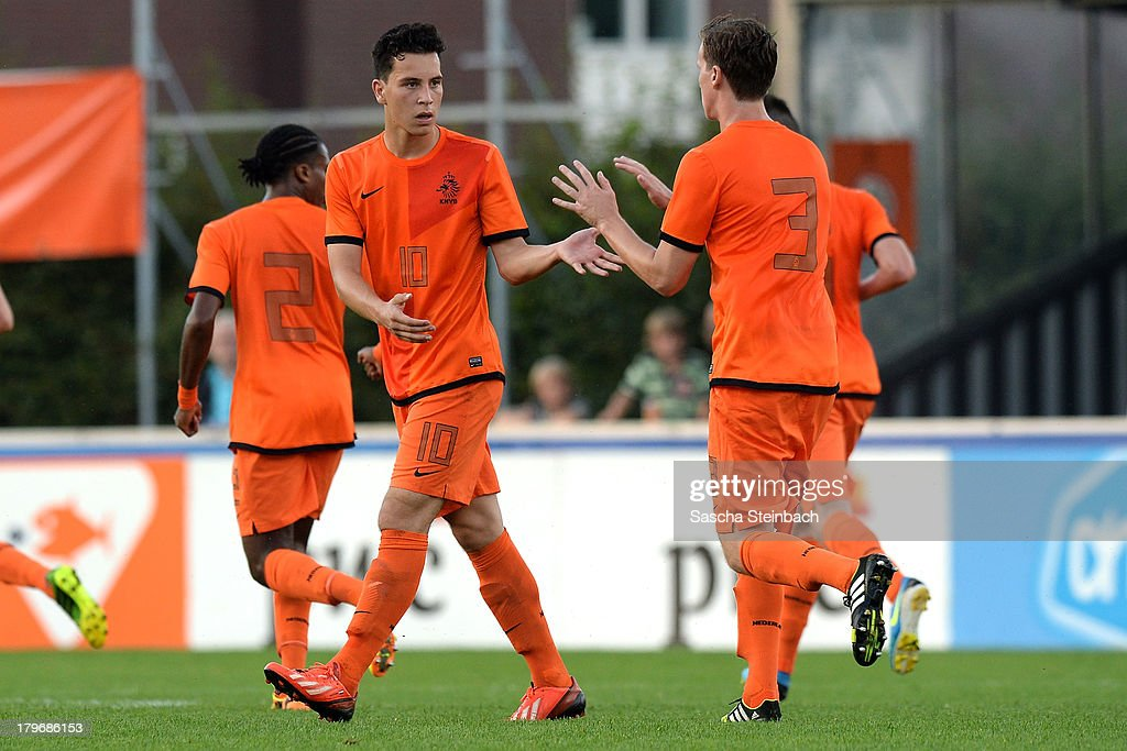Thom Haye (L) from The Netherlands celebrates scoring his team's 1st goal during the U19 international friendly match between The Netherlands and Germany on September 6, 2013 in Nijmegen, Netherlands.