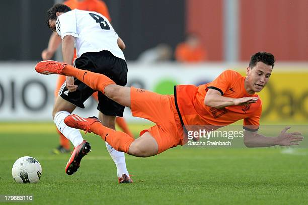 Thom Haye from The Netherlands is tackled by Levin Oeztunali from Germany during the U19 international friendly match between The Netherlands and...