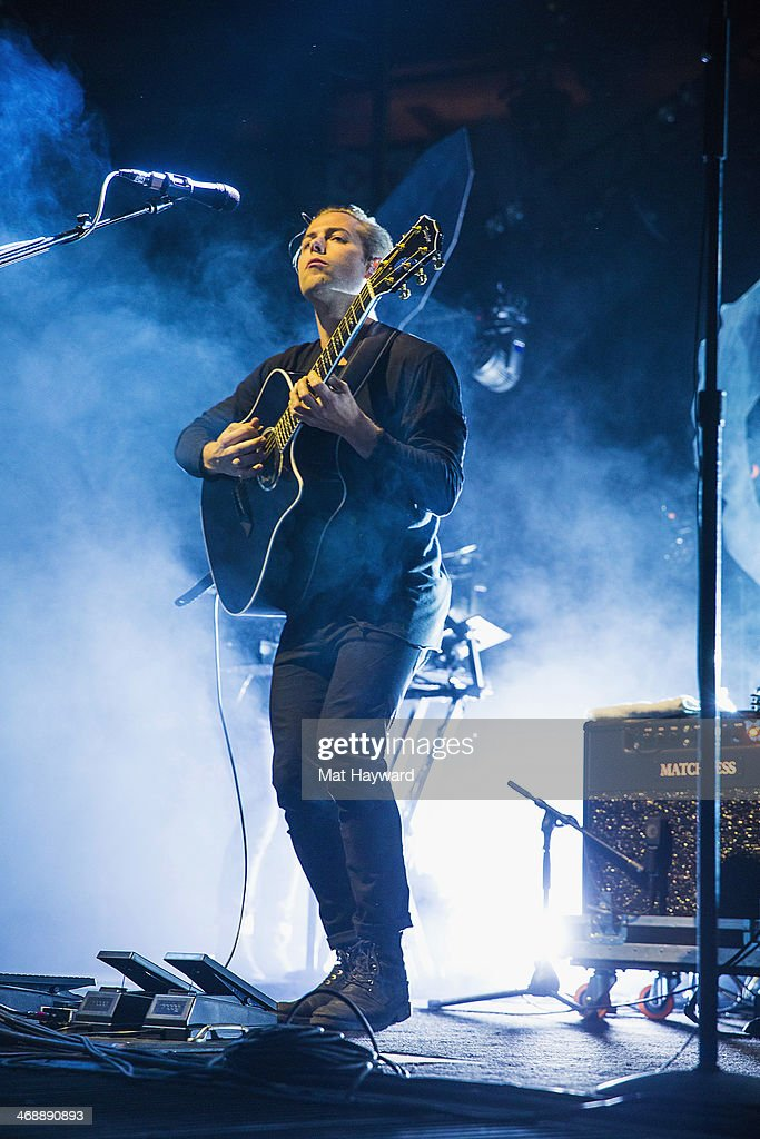 <a gi-track='captionPersonalityLinkClicked' href=/galleries/search?phrase=Thom+Powers+-+Musician&family=editorial&specificpeople=15211677 ng-click='$event.stopPropagation()'>Thom Powers</a> of Naked and Famous performs on stage at KeyArena on February 11, 2014 in Seattle, Washington.