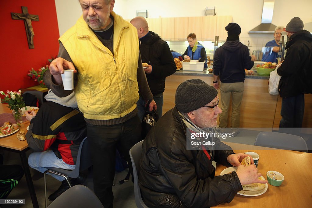 Thomas (R), a 63-year-old homeless man, eats a free lunch at the Bahnhofsmission Protestant charity facility with other needy visitors at Zoo train station on February 20, 2013 in Berlin, Germany. The Bahnhofsmission feeds up to 600 needy men and women every day, up from 400 only three years ago. Approximately 60% of the visitors are from Eastern Europe, many of them workers in low-paying jobs who became unemployed and ran out of money. Dieter Puhl, who runs the Bahnhofsmission, says he is seeing a steady increase in the number of visitors, especially among older Germans whose pensions are insufficient for them to make ends meet. Poverty in Germany, defined as someone who makes less than 60% of the median wage, has risen steadily in recent years, and according to statistics 14% of people in Germany lived below the poverty line in 2010. Both poverty and pensions that have not kept up with the rising cost of living will be contested topics in federal elections scheduled later for this year.