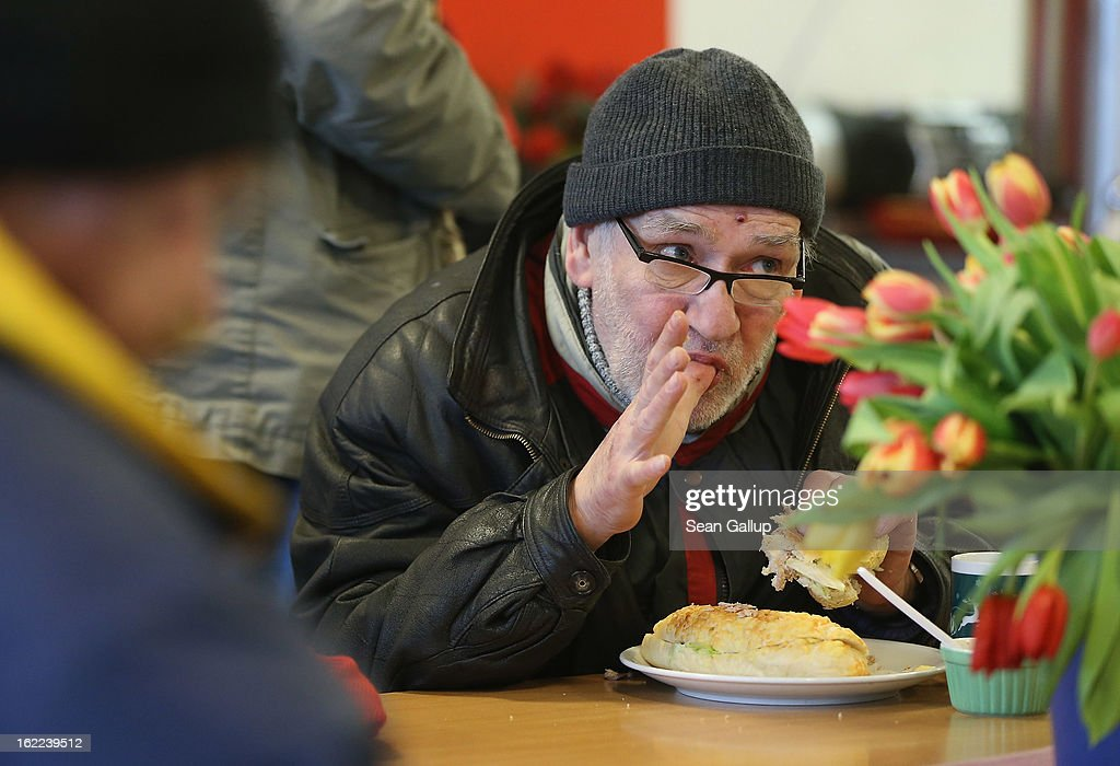 Thomas, a 63-year-old homeless man, eats a free lunch at the Bahnhofsmission Protestant charity facility at Zoo train station on February 20, 2013 in Berlin, Germany. The Bahnhofsmission feeds up to 600 needy men and women every day, up from 400 only three years ago. Approximately 60% of the visitors are from Eastern Europe, many of them workers in low-paying jobs who became unemployed and ran out of money. Dieter Puhl, who runs the Bahnhofsmission, says he is seeing a steady increase in the number of visitors, especially among older Germans whose pensions are insufficient for them to make ends meet. Poverty in Germany, defined as someone who makes less than 60% of the median wage, has risen steadily in recent years, and according to statistics 14% of people in Germany lived below the poverty line in 2010. Both poverty and pensions that have not kept up with the rising cost of living will be contested topics in federal elections scheduled later for this year.