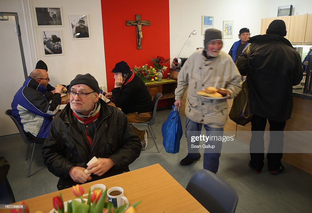 Thomas (L), a 63-year-old homeless man, eats a free lunch with other needay visitors at the Bahnhofsmission Protestant charity facility at Zoo train station on February 20, 2013 in Berlin, Germany. The Bahnhofsmission feeds up to 600 needy men and women every day, up from 400 only three years ago. Approximately 60% of the visitors are from Eastern Europe, many of them workers in low-paying jobs who became unemployed and ran out of money. Dieter Puhl, who runs the Bahnhofsmission, says he is seeing a steady increase in the number of visitors, especially among older Germans whose pensions are insufficient for them to make ends meet. Poverty in Germany, defined as someone who makes less than 60% of the median wage, has risen steadily in recent years, and according to statistics 14% of people in Germany lived below the poverty line in 2010. Both poverty and pensions that have not kept up with the rising cost of living will be contested topics in federal elections scheduled later for this year.
