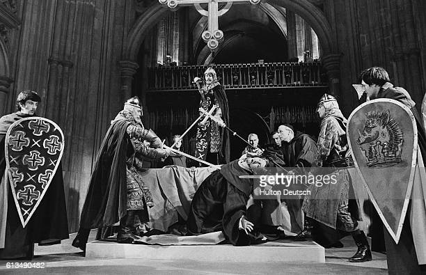 Thomas a Becket played by John Westbrook is murdererd in a scene from TS Eliot's play Murder in the Cathedral staged in Canterbury Cathedral