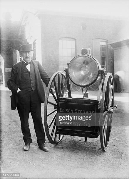Thomas A Edison inspecting his latest invention a portable searchlight capable of producing any volume of light up to 3000 candle power