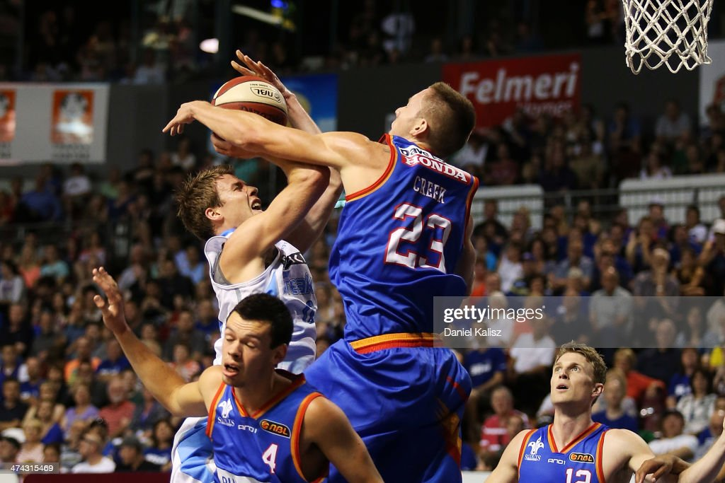 Thomas Abercrombie of the Breakers takes a shot over Mitchell Creek of the Sixers during the round 19 NBL match between the Adelaide 36ers and the New Zealand Breakers at Adelaide Arena in February 23, 2014 in Adelaide, Australia.
