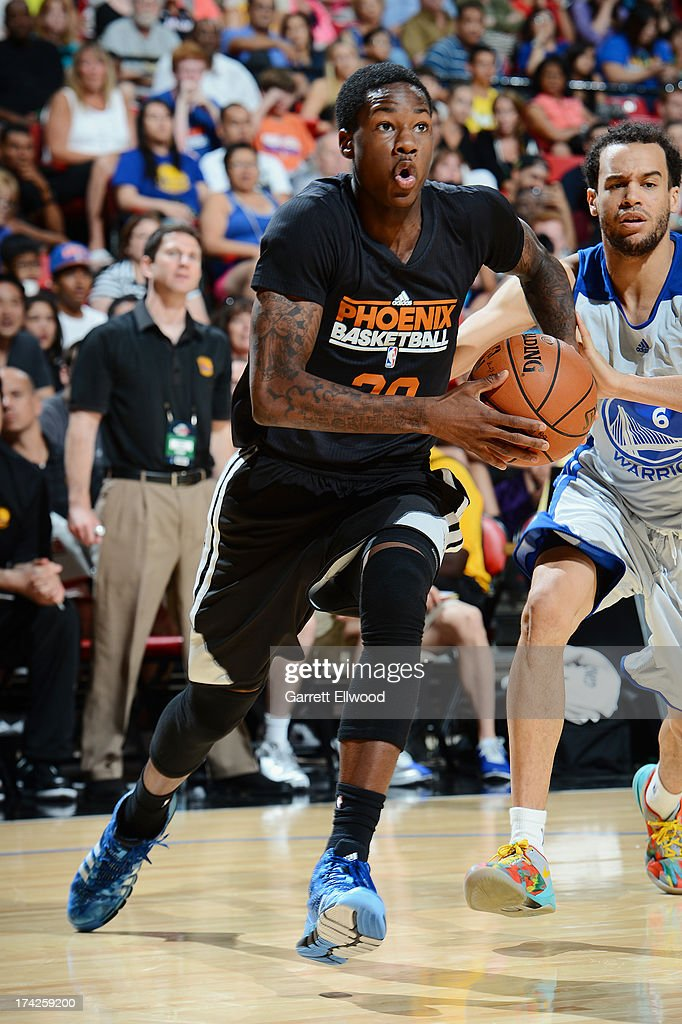 Thomas Abercrombie #20 of the Phoenix Suns drives to the basket against the Golden State Warriors during NBA Summer League Championship Game on July 22, 2013 at the Cox Pavilion in Las Vegas, Nevada.