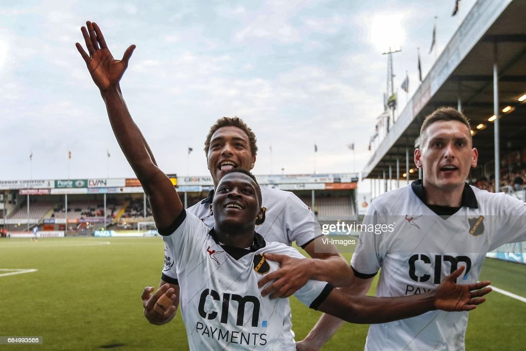 http://media.gettyimages.com/photos/thomas-agyepong-of-nac-breda-cyriel-dessers-of-nac-breda-shane-o-of-picture-id684993566