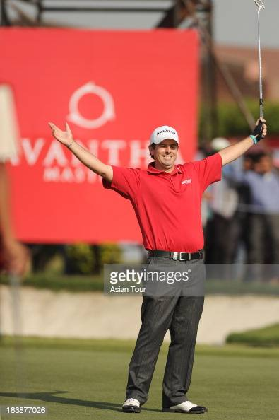 Thomas Aiken of South Africa celebrates after birdie putt at eighteen holes to win the Avantha Masters 2013 at Jaypee Greens Golf Course on March 17...