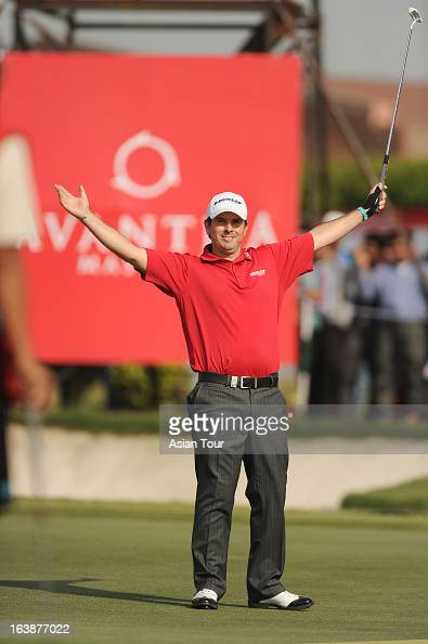 Thomas Aiken of South Africa celebrates at eighteen holes during day 4 of the Avantha Masters at Jaypee Greens Golf Course on March 17 2013 in Noida...