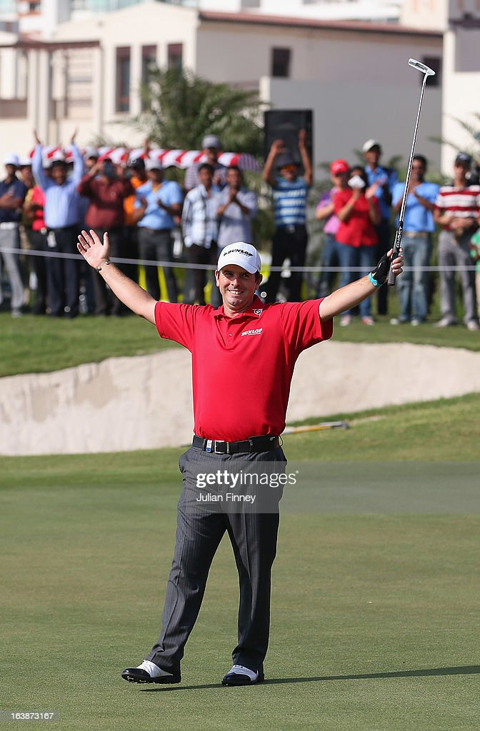Thomas Aiken of South Africa celebrates victory on the 18th green after a birdie putt during day four of the Avantha Masters at Jaypee Greens Golf...