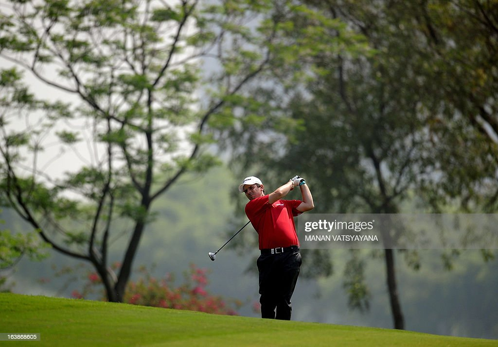 Thomas Aiken of South Africa drives the ball on the second green during the final day of the Avantha Masters golf tournament in Greater Noida on the...