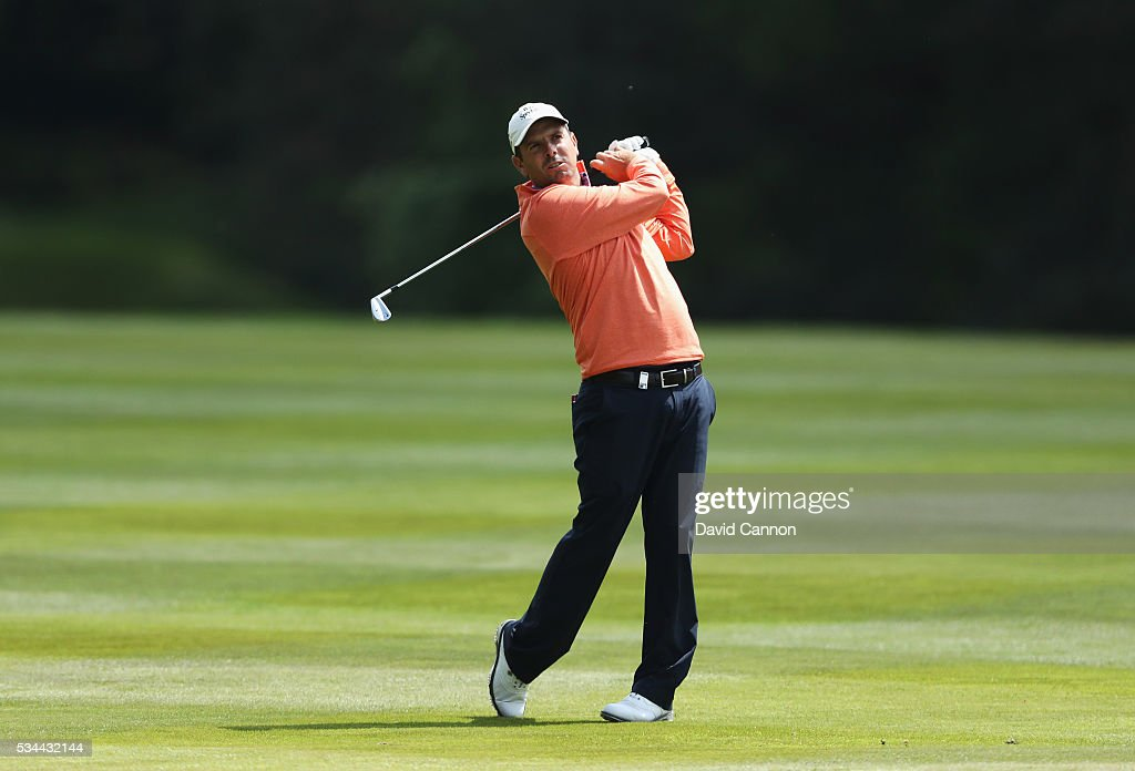 Thomas Aiken of South Africa hits his 2nd shot on the 9th hole during day one of the BMW PGA Championship at Wentworth on May 26, 2016 in Virginia Water, England.
