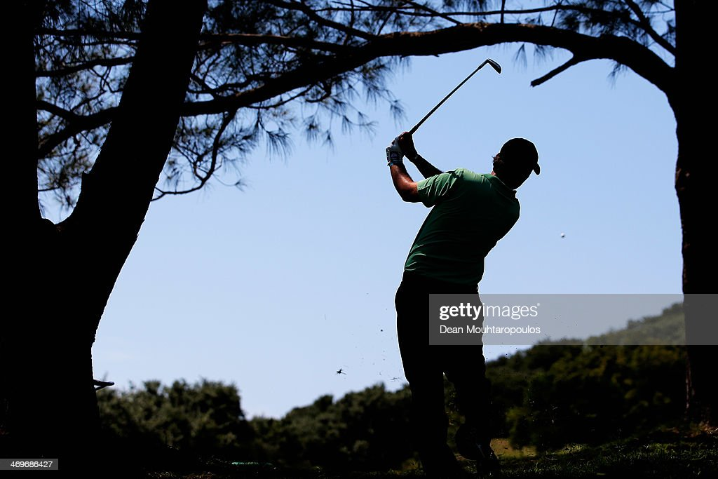 <a gi-track='captionPersonalityLinkClicked' href=/galleries/search?phrase=Thomas+Aiken&family=editorial&specificpeople=2088884 ng-click='$event.stopPropagation()'>Thomas Aiken</a> of South Africa hits his second shot on the 1st hole during Final Day of the Africa Open at East London Golf Club on February 16, 2014 in East London, South Africa.