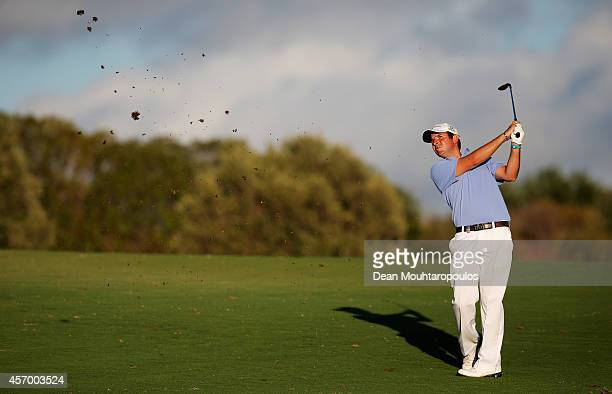Thomas Aiken of South Africa hits his second shot on the 4th hole during Day 2 of the Portugal Masters held at the Oceanico Victoria Golf Course on...