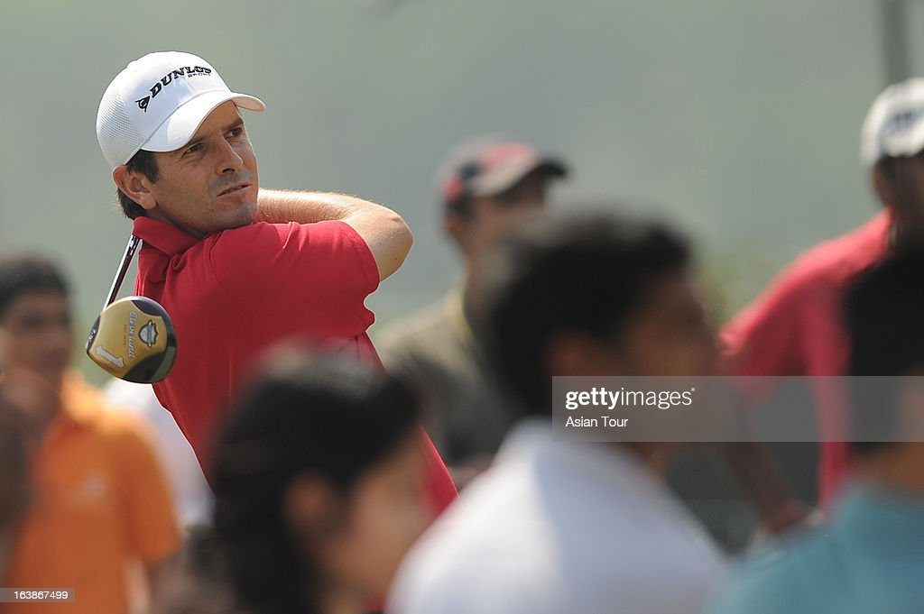 Thomas Aiken of South Africa plays a shot during day 4 of the Avantha Masters at Jaypee Greens Golf Course on March 17 2013 in Noida India