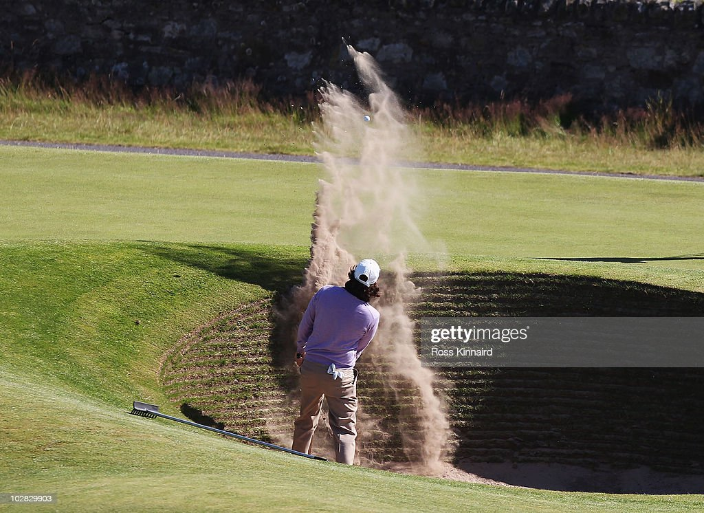 <a gi-track='captionPersonalityLinkClicked' href=/galleries/search?phrase=Thomas+Aiken&family=editorial&specificpeople=2088884 ng-click='$event.stopPropagation()'>Thomas Aiken</a> of South Africa plays from the 'Road Hole Bunker' on the par 4, 17th hole during practice for the 139th Open Championship on the Old Course, St Andrews on July 12, 2010 in St Andrews, Scotland.