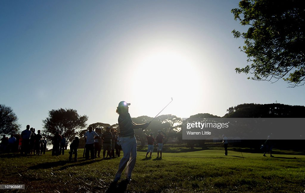 <a gi-track='captionPersonalityLinkClicked' href=/galleries/search?phrase=Thomas+Aiken&family=editorial&specificpeople=2088884 ng-click='$event.stopPropagation()'>Thomas Aiken</a> of South Africa plays his seocnd shot into the 15th green during the first round of the Africa Open at East London GC on January 6, 2011 in East London, South Africa.