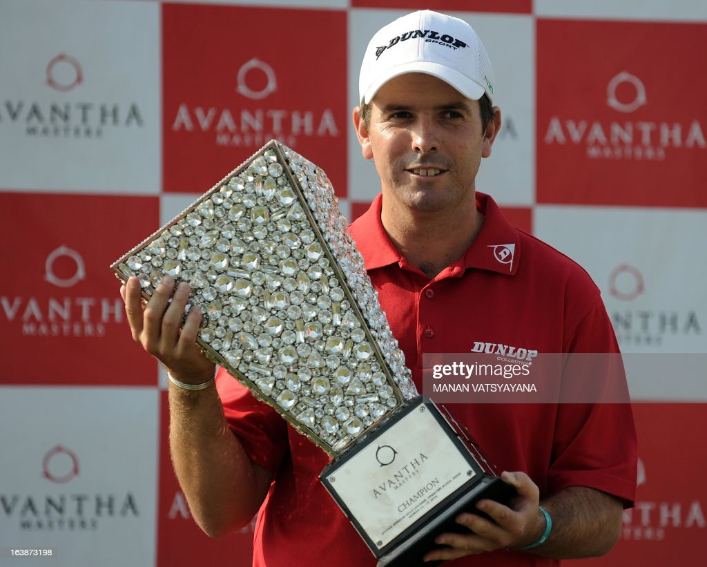 Thomas Aiken of South Africa poses with the trophy after winning the Avantha Masters golf tournament in Greater Noida on the outskirts of New Delhi...
