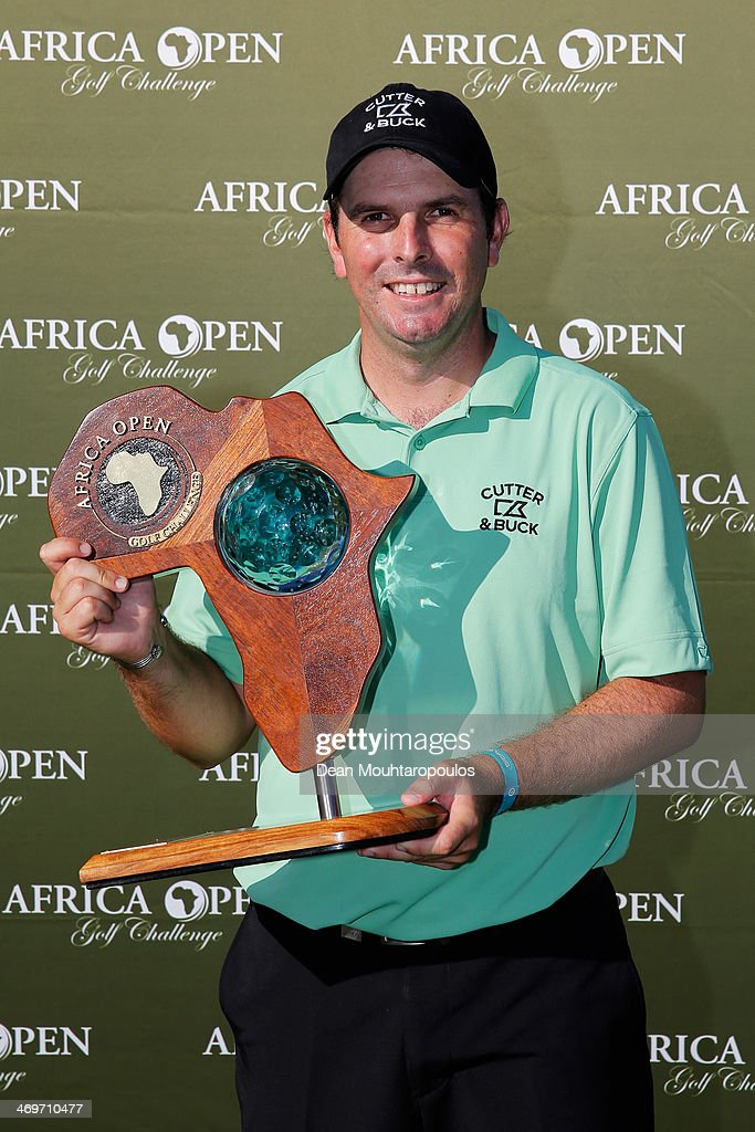 <a gi-track='captionPersonalityLinkClicked' href=/galleries/search?phrase=Thomas+Aiken&family=editorial&specificpeople=2088884 ng-click='$event.stopPropagation()'>Thomas Aiken</a> of South Africa poses with the trophy after winning the Africa Open at East London Golf Club on February 16, 2014 in East London, South Africa.