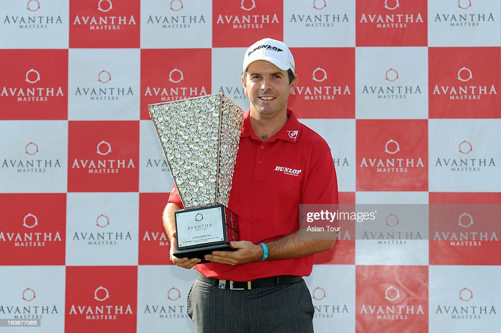 Thomas Aiken of South Africa poses with trophy after winning the Avantha Masters at Jaypee Greens Golf Course on March 17 2013 in Noida India
