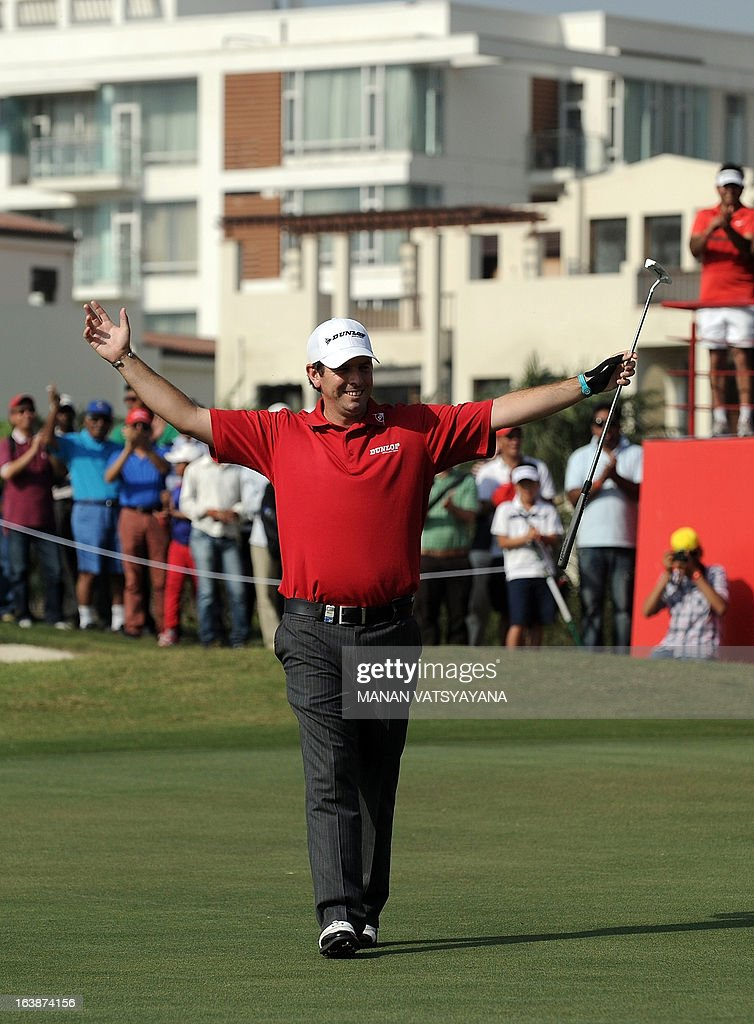 Thomas Aiken of South Africa reacts after hitting a birdie on the eighteenth hole to win the Avantha Masters golf tournament in Greater Noida, on the outskirts of New Delhi on March 17, 2013. AFP PHOTO/ MANAN VATSYAYANA