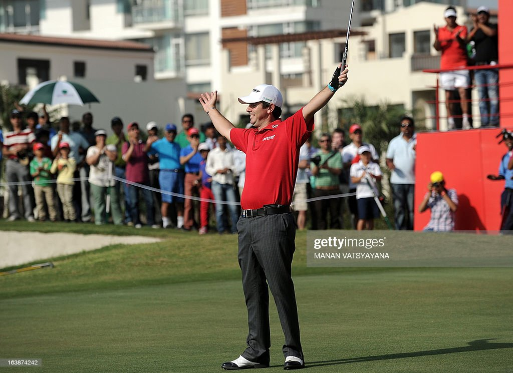 Thomas Aiken of South Africa reacts after hitting a birdie on the eighteenth hole to win the Avantha Masters golf tournament in Greater Noida on the...