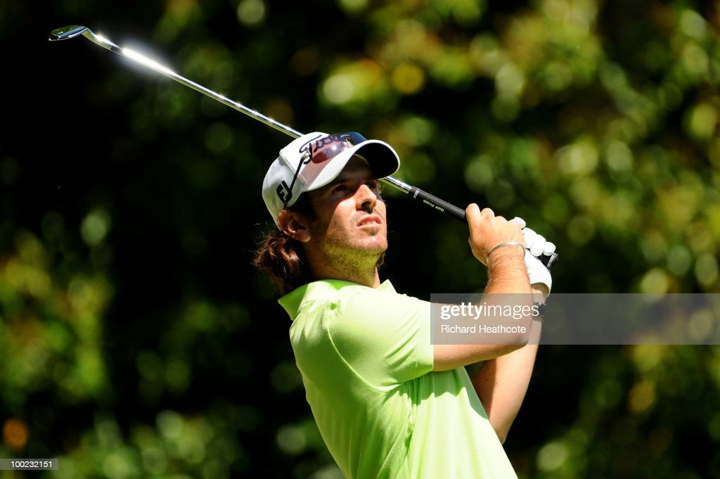 <a gi-track='captionPersonalityLinkClicked' href=/galleries/search?phrase=Thomas+Aiken&family=editorial&specificpeople=2088884 ng-click='$event.stopPropagation()'>Thomas Aiken</a> of South Africa tees off on the 2nd hole during the third round of the BMW PGA Championship on the West Course at Wentworth on May 22, 2010 in Virginia Water, England.