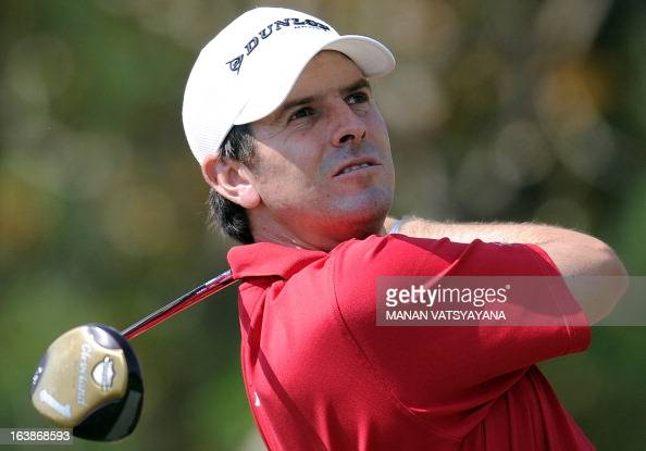 Thomas Aiken of South Africa tees off on the fifth hole during the final day of the Avantha Masters golf tournament in Greater Noida on the outskirts...