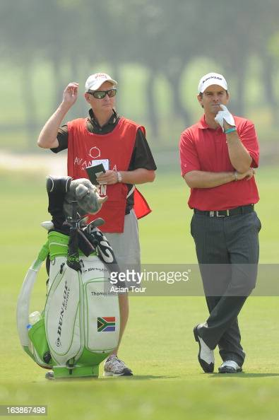 Thomas Aiken of South Africa with his caddies during day 4 of the Avantha Masters at Jaypee Greens Golf Course on March 17 2013 in Noida India