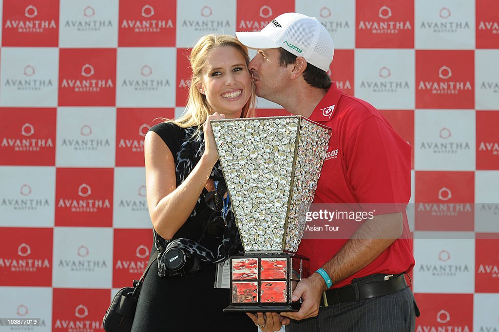 Thomas Aiken of South Africa with his wife poses with the trophy after winning the Avantha Masters 2013 at Jaypee Greens Golf Course on March 17 2013...