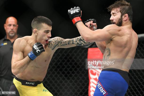 Thomas Almeida lands a left hand on Jimmie Rivera during their UFC Fight Night bantamweight bout at the Nassau Veterans Memorial Coliseum on July 22...
