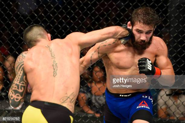 Thomas Almeida of Brazil punches Jimmie Rivera in their bantamweight bout during the UFC Fight Night event inside the Nassau Veterans Memorial...