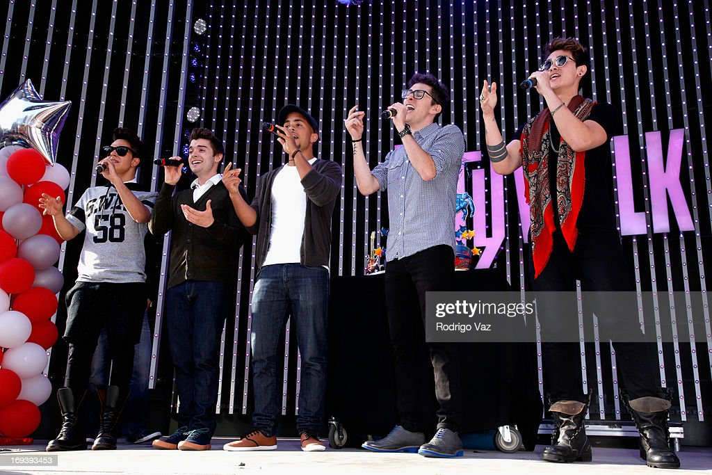 Thomas Augusto, Colton Rudloff, Joey Diggs Jr., Eric Secharia and Anthony Ladao of Midnight Red perform at Universal CityWalk 20th Anniversary event featuring 8 original cars from 'Fast & The Furious' movie franchise at 5 Towers Outdoor Concert Arena on May 23, 2013 in Universal City, California.