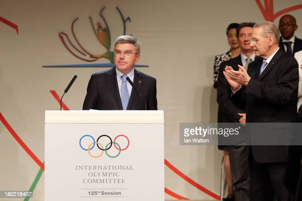 Thomas Bach is announced as the ninth IOC President by President of the IOC Jacques Rogge during the 125th IOC Session IOC Presidential Election at...