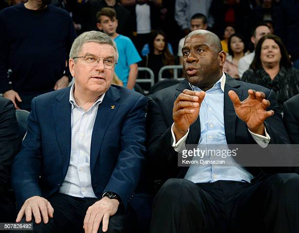 Thomas Bach president of the International Olympic Committee and Lakers legend and Olympian Earvin 'Magic' Johnson attend the basket ball game...
