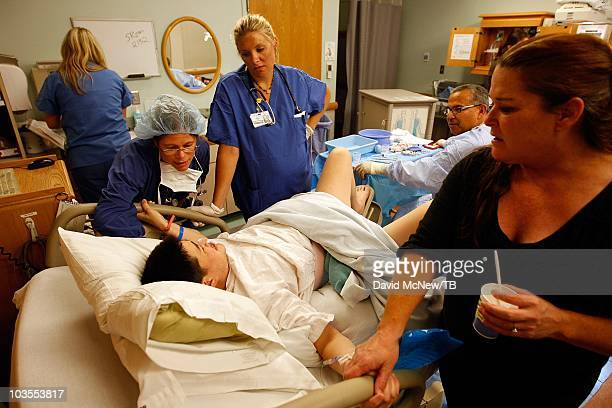 Thomas Beatie a transgender male gives birth to son Jensen James Beatie with his wife Nancy by his side at Saint Charles Medical Center on July 25...
