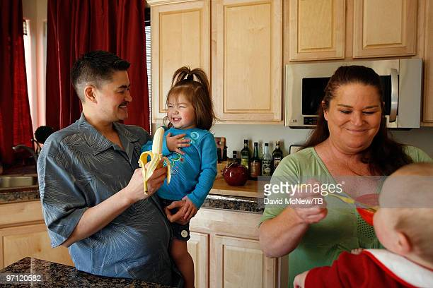 Thomas Beatie and wife Nancy Beatie feed daughter Susan Juliette Beatie and son Austin Alexander Beatie on February 17 2010 in Bend Oregon Thomas a...