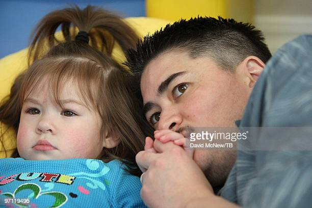 Thomas Beatie spends watches television with his daughter Susan Juliette Beatie on February 17 2010 in Bend Oregon Thomas a transgender male is 17...