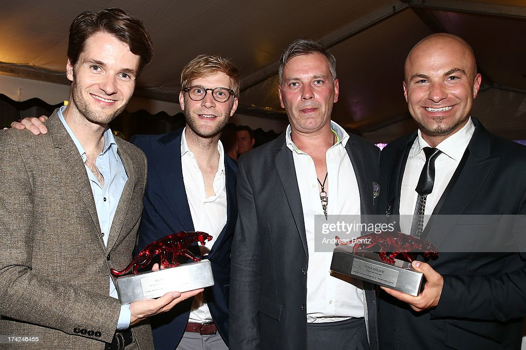 Thomas Bentz, Oliver Luehr, Martin Obermeyr and Tom Zauke with the awards at KARE Design at the New Faces Award Fashion 2013 at Rheinterrasse on July 22, 2013 in Duesseldorf, Germany.
