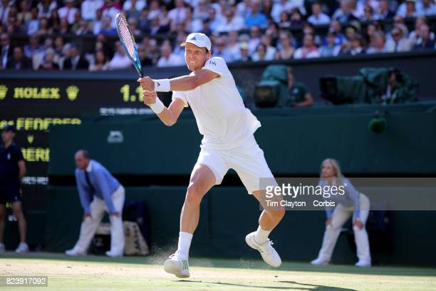 Thomas Berdych of the Czech Republic in action against Roger Federer of Switzerland in the Gentlemen's Singles Semifinal of the Wimbledon Lawn Tennis...