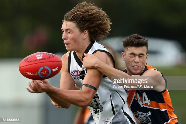 Thomas Berry of the Rebels is tackled during the round four TAC Cup match between the Northern Knights and the Murray Bushrangers at RAMS Arena on...