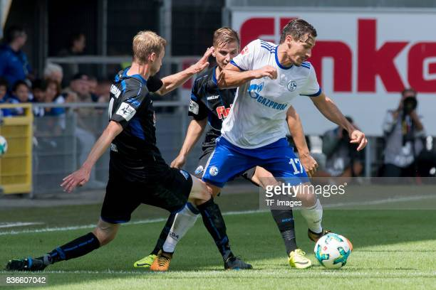 Thomas Bertels of Paderborn and Benjamin Stambouli of Schalke battle for the ball during the preseason friendly match between SC Paderborn and FC...