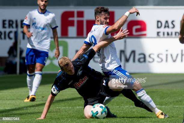 Thomas Bertels of Paderborn and Daniel Caligiuri of Schalke battle for the ball during the preseason friendly match between SC Paderborn and FC...