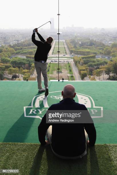 Thomas Bjorn Captain of Europe tee off from a platform on the Eiffel Tower as Jim Furyk Captain of The United States looks on during the Ryder Cup...