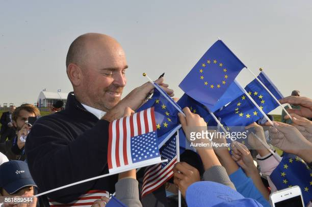 Thomas Bjorn of Denmark Captain of the Ryder Cup 2018 signs autographs during the Captain's Challenge at Golf National on October 16 2017 in...